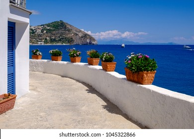 Beautiful seaview at the cape in Sant Angelo from the promenade along the sea, Ischia, Italy.