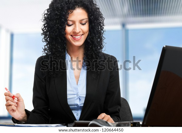 Beautiful secretary at work in her office