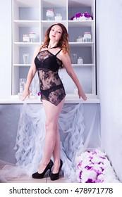 Beautiful seductive brunette in black lingerie