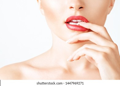 Beautiful seductive female lips with glossy lipstick. Slightly parted sensual mouth of a woman. Healthy white teeth. The concept of a kiss of temptation. Advertising image for a beauty salon
