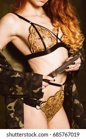 Beautiful seductive redhead in lingerie