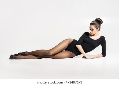 Beautiful, seductive woman posing in hosiery over white background.
