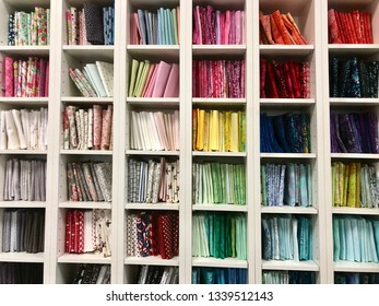 A beautiful selection of fabric fat quarters at a local quilt shop.