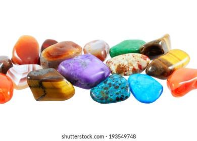 Beautiful semi-precious stones against white background