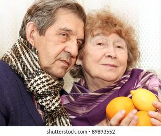 beautiful senior couple with fresh fruit