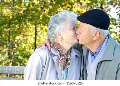 Beautiful senior couple kissing in autumn