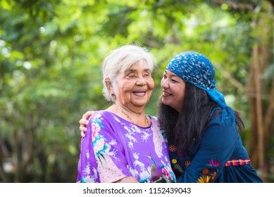Beautiful senior mom and her adult daughter are hugging,