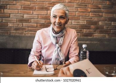 Beautiful senior woman conducting a job interview.