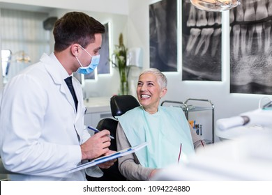 Beautiful senior woman at dentist's office satisfied after successful dental treatment.