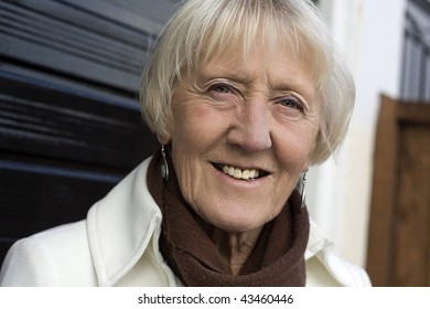 a beautiful senior woman in her 60s ready to go out