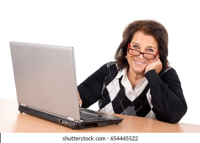 Beautiful senior woman with laptop isolated in white