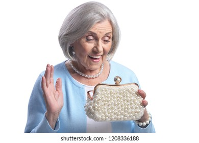 Beautiful senior woman with purse on white background