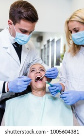 Beautiful senior woman receiving a dental treatment. Close up shot.