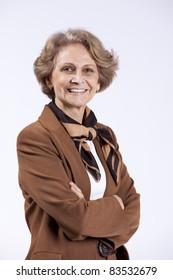 Beautiful senior woman smiling (isolated on white)