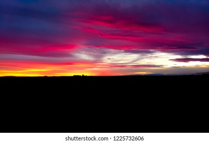 beautiful senset with vibrant colors and a nice landscape silhouette
