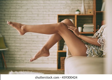 Beautiful sensual bare legs of young woman