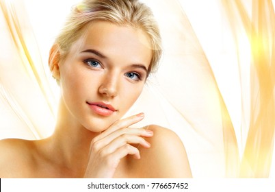 Beautiful sensual blonde girl on wavy orange background. Beauty concept