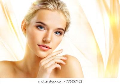 Beautiful sensual blonde girl on wavy orange background. Beauty concept