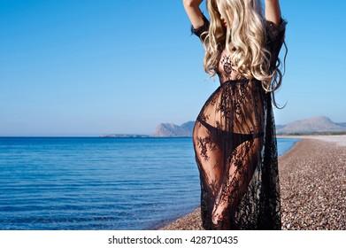 Beautiful sensual blonde at the sea. Summer travel photos