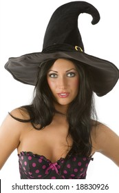 beautiful and sensual brunette with blue eyes and hat of witch on