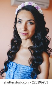 Beautiful sensual brunette bride with elegant hairstyle. Wedding dress. Fashion photo
