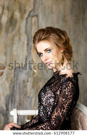 2035ab0b1e44 Beautiful sensual girl with blond hair in black lace lingerie in loft  interior