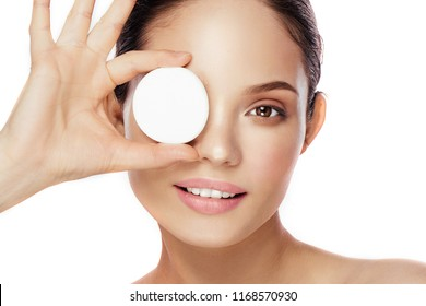 Beautiful sensual girl cleaning her face with cotton swab pad.  Skin care and beauty