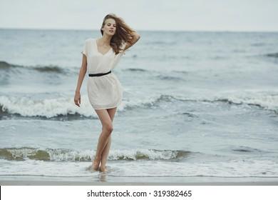beautiful sensual girl in cold water portrait