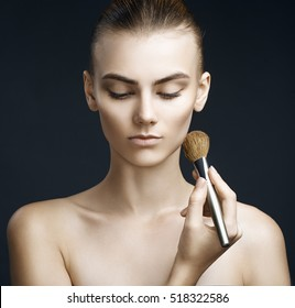 Beautiful sensual woman applying make-up. Perfect makeup. Beauty fashion. Eyelashes. Lips. Cosmetic Eyeshadow.