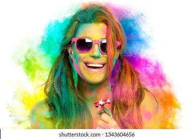 Beautiful sensual woman covered in rainbow colored powder celebrating Holi Festival smiling at camera in a beauty spring concept. Gorgeous young woman having fun with colorful powder
