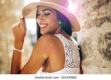 Beautiful sensual woman in hat being truly happy and positive