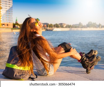 Beautiful sensuality elegance brunette woman, has happy fun cheerful smiling face, white shirt, blue jeans shorts. Has slim sport tan body. Motion on great rollerblading urban city. Portrait nature.