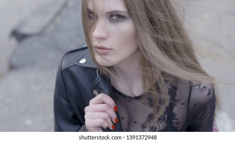 Beautiful sensuality elegance lady brunette woman happy face. Action. Beautiful young woman in urban environment