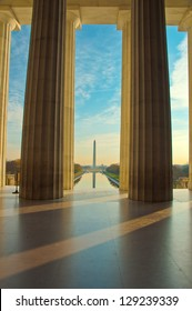 Beautiful serene dawn reflects Washington Monument in the new Reflecting Pool. Framed by pillars from the Lincoln Memorial. Washington, DC
