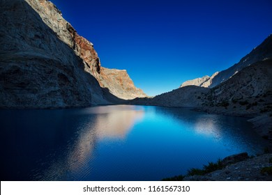 Beautiful serene lake in  Fann mountains (branch of Pamir) in Tajikistan.