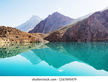 Beautiful serene lake in  Fanns mountains (branch of Pamir) in Tajikistan.