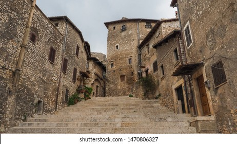 Beautiful Sermoneta town center with a wide stairs and old medieval houses with the view of the famous Caetani Castle Tower on top, province of Latina, Lazio, Italy. Traditional Italian landscape.