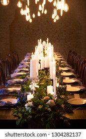 Beautiful served wedding table with decor as candles, greenness. Banquet dinner party
