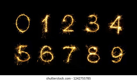 Beautiful set of Fireworks numbers 0, 1, 2, 3, 4, 5, 6, 7, 8, 9. Burning sparkler Numbers isolated on black background. Numbers of Sparklers to overlay on texture for design