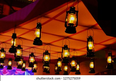 A beautiful set of lanterns hanging in the roof of a  garden at night. This picture is captured during Durga pujo festival in West Bengal.