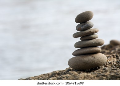 A beautiful set of rocks stacked on the seaside
