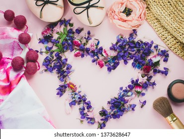 beautiful set of women's fashion accessories and cosmetics on a pink background