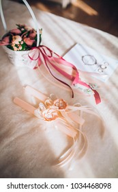Beautiful set of women's wedding accessories. Bride's morning. Pink shoes.  Candles in powder color.