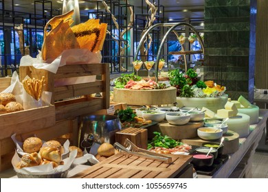 Beautiful setup of bread and salad bar station at seafood market buffet in the restaurant.