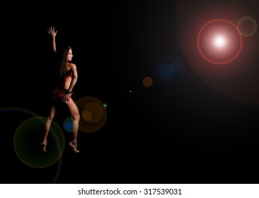 Beautiful sexual girl model in erotic cloth pose on black background