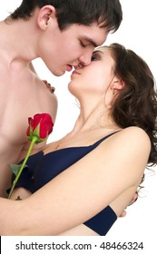 Beautiful sexual half naked kissing couple isolated over white background
