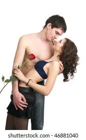 Beautiful sexual semi-dressed couple isolated over white background