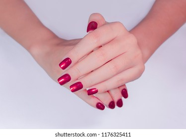 beautiful sexy attractive shimmer bright purple color gel nail art on fashionista elegance young woman fingernails isolated on white background