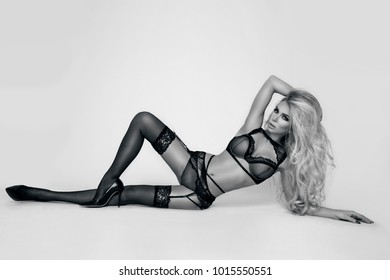 Beautiful, sexy blond model, dressed only in elegant, sensual  lingerie.