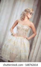 Beautiful sexy blond woman in golden dress, beauty and fashion girl. Vogue style bride. Retro woman portrait outdoors. Luxury. Glamour woman with blonde curly hair and bright makeup.